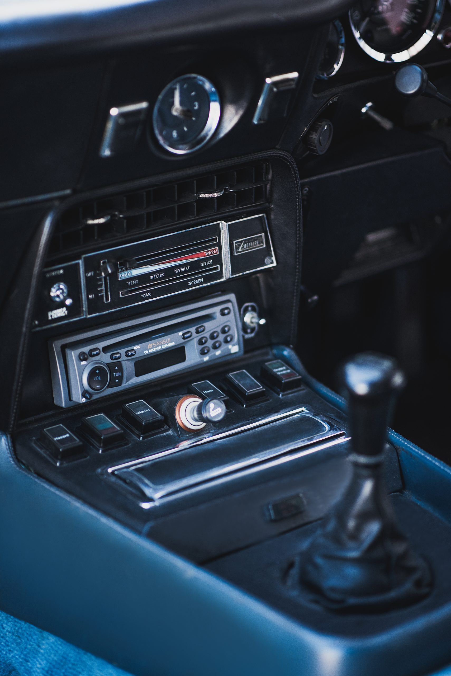 Detail shot of middle panel with the gear stick and radio